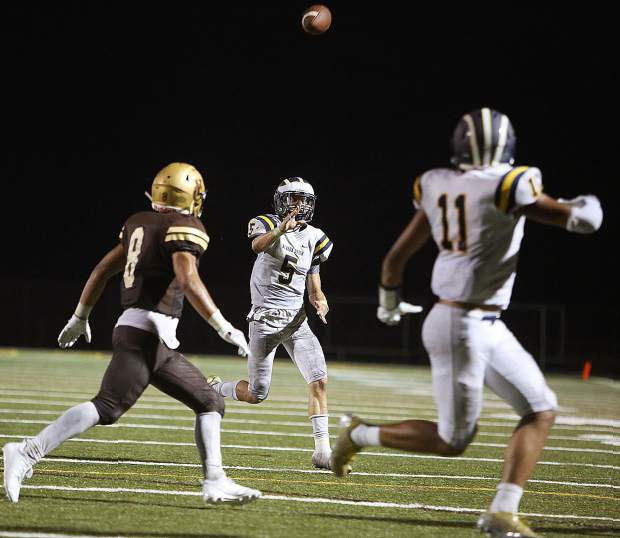 Nevada Union quarterback Dawson Fay (5) lobs a pass towards a player in the end zone during Friday's 39-0 loss against the Yuba City Honkers.