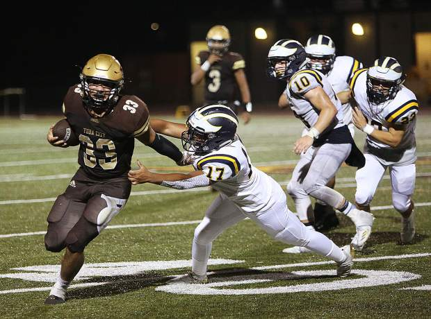 Nevada Union's Imani Walker (17) tries to stop a Yuba City ball carrier during Friday's loss to the Honkers.