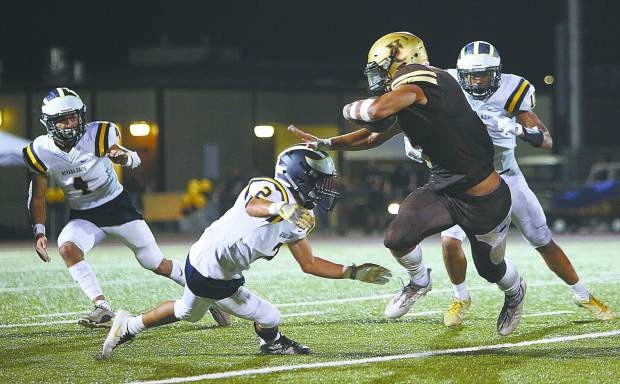 NU senior Dereck Lopez (2) looks to make a tackle of a Yuba City ball carrier during Friday's road loss to the Honkers.
