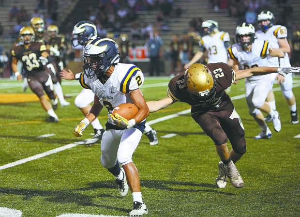 Nevada Union's Dereck Lopez (2) runs the ball up the sideline during a play against the Yuba City Honkers.
