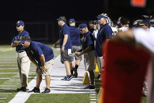 Nevada Union coaches look for adjustments to be made to the team during Friday's high school football road opener against the Yuba City Honkers.