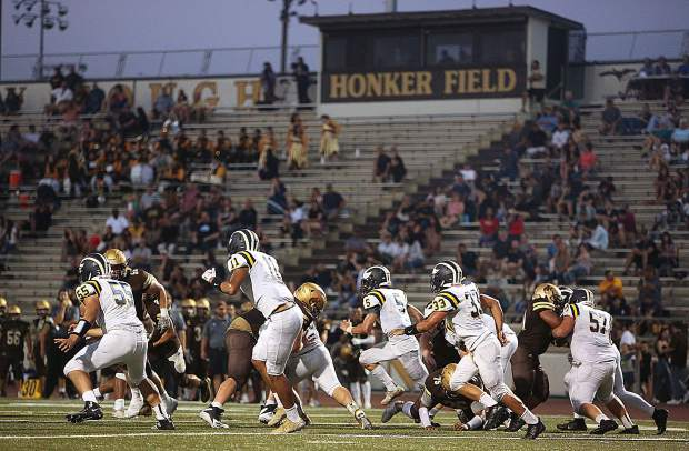 The Nevada Union Miner defense faces the Yuba City Honkers' offense at the line of scrimmage during Friday's matchup at Honker Field in Yuba City.