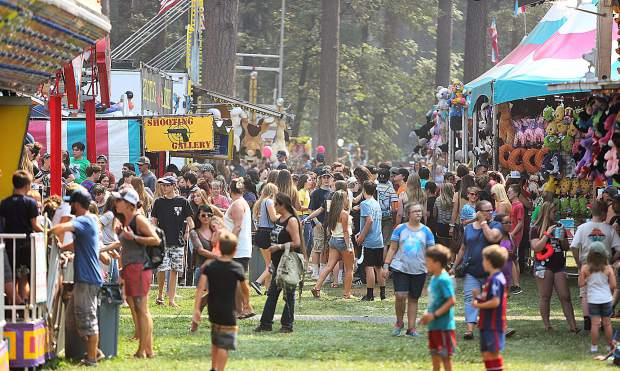 Youngsters and their families fill the midway of fun at the Nevada County Fairgrounds on opening day Wednesday afternoon.