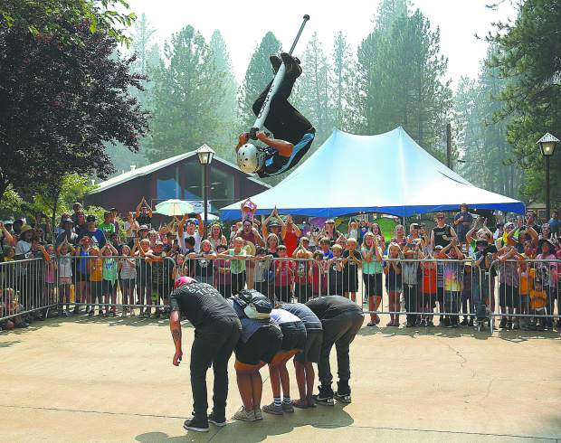 Members of the Xpogo Stunt Team out of Pittsburgh Pennsylvania, wow the crowds with their mixture of gravity defying pogo stunts Wednesday afternoon. XPogo has multiple daily performances at the Dance Pad.