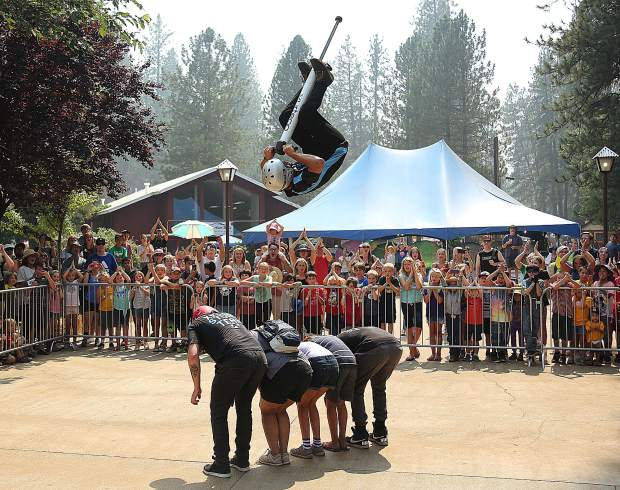 Members of the XPogo Stunt Team out of Pittsburgh Pennsylvania wow the crowds with their mixture of gravity defying pogo stunts Wednesday afternoon. XPogo has multiple daily performances at the Dance Pad.