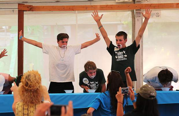 Damian Killion (left) and Nathan Ramey put their hands in the air after they finish eating Jell-O during the Jell-O eating contest.