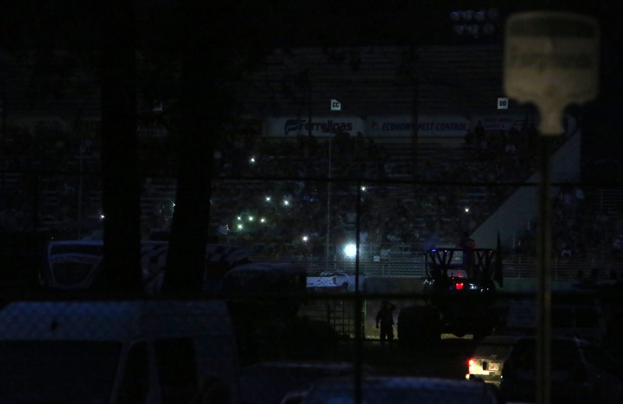 Fair goers utilized cell phone lights to make their way out of the Nevada County Fairgrounds arena where the monster truck show was in full swing before the power outage and subsequent vegetation fire.