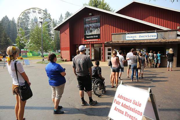 A line forms for advance tickets Tuesday afternoon at the front gate.