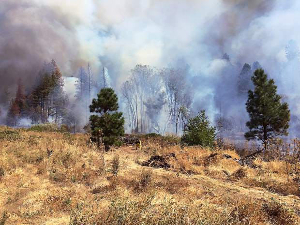 Heavy smoke rises from a vegetation fire that threatened Empire Mine State Park in Grass Valley Saturday afternoon.