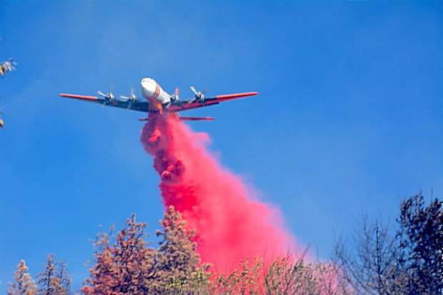 An airt tanker drops retardent on the Empire Mine fire.