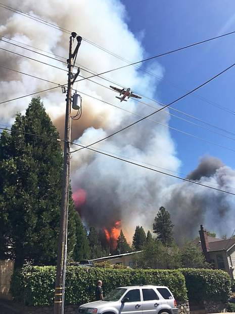 Cal Fire Air Attack flies over the 40-acre fire in Grass Valley near Empire Mine State Park.