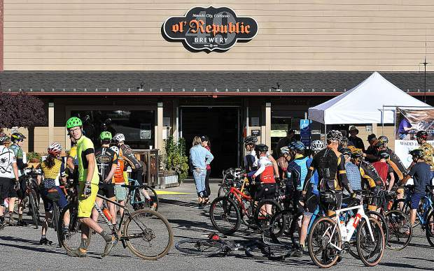 The riders prepare for one of two different rides, a 60 mile or 30 mile ride, Saturday at ol' Republic Brewery during the Big Brothers Big Sisters Gourmet Gravel Grinder fundraising mountain bike ride through Nevada County's river canyons.