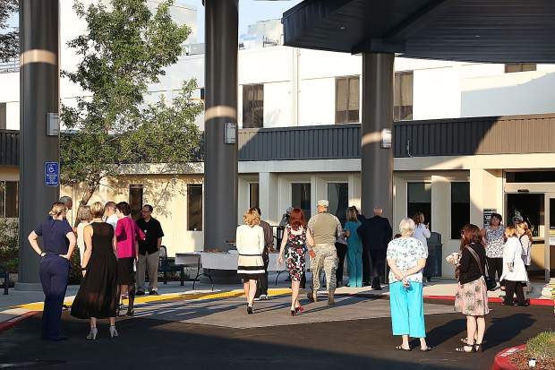 Hospital staff fill the new entryway of the Sierra Nevada Memorial Hospital during Wednesday morning's ribbon cutting ceremony.