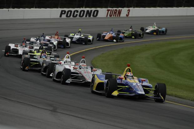 Alexander Rossi (27) leads the field during the IndyCar auto race at Pocono Raceway, Sunday in Long Pond, Pa. Rossi led 180 of 200 laps on his way to a first place finish.