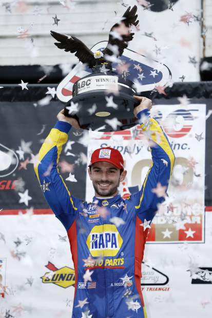 Alexander Rossi poses in Victory Lane after winning the IndyCar auto race at Pocono Raceway, Sunday in Long Pond, Pa.