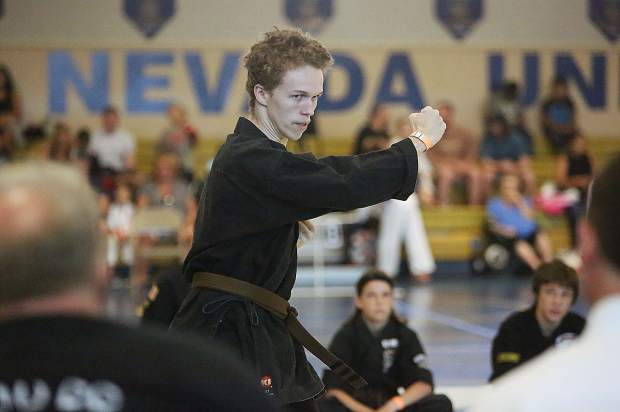 Redding's Drake Serr exhibits his form for the crowds during Saturday's Gold Mountain Invitational Karate Tournament. Serr, who has been evacuated from his home in Redding, was last year's grand champion and will be testing for his black belt in September.