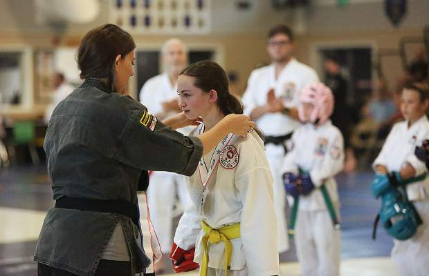 Dakota Johnson receives a silver medal during following the sparring portion of Saturday's Gold Mountain Invitational Karate Tournament.