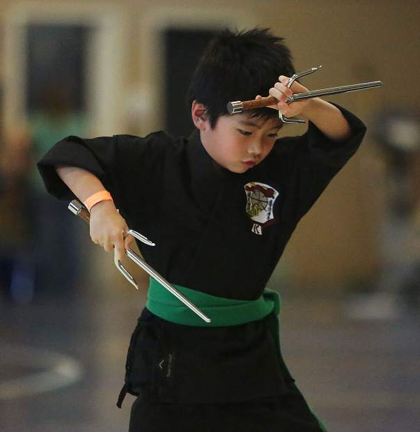 Seven year old Hunter Yasuda, from Folsom, uses his sais during the 7-8 year old weapons formations competition during the Gold Mountain Invitational Karate Tournament at Nevada Union. Yasuda earned second place.