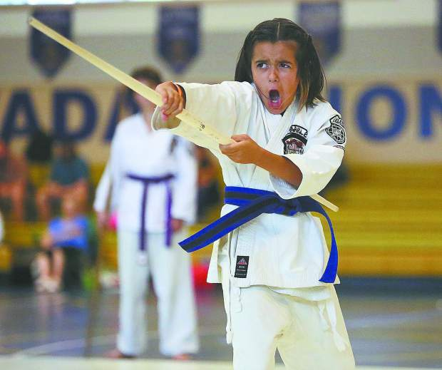 Grass Valley's Marley Lopin works on her weapons demonstration routine during Saturday's Gold Mountain Invitational Karate Tournament at Nevada Union High School.
