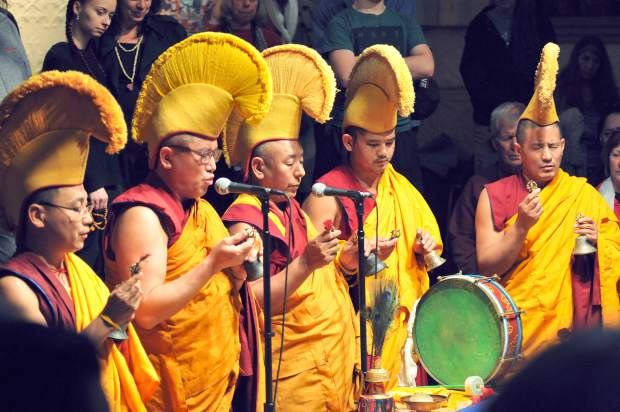 The five visiting Tibetan Buddhist monks chant, pray and play musical instruments over the mandala before dissolving the mandala during Saturday's closing ceremony at St. Joseph's Cultural Center.