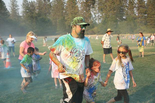 Adults happily took part in the color run alongside their children during Tuesday's National Night Out held this year at DeVere Mautino Park in Grass Valley.