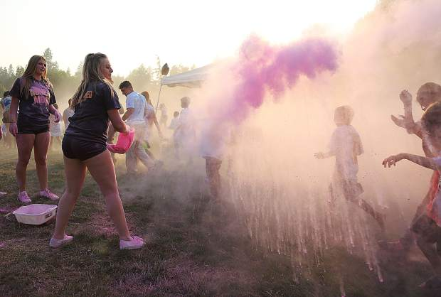 Members of the Nevada Union High School cheerleaders were happy to be a part of Tuesday's National Night Out event as they could be seen throwing plumes of pink clouds in to the sky above DeVere Mautino Park.