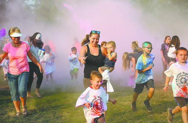 Adults happily took part in the color run alongside their children during last year's National Night Out. This year's National Night Out is Aug. 6 at Pioneer Park in Nevada City.