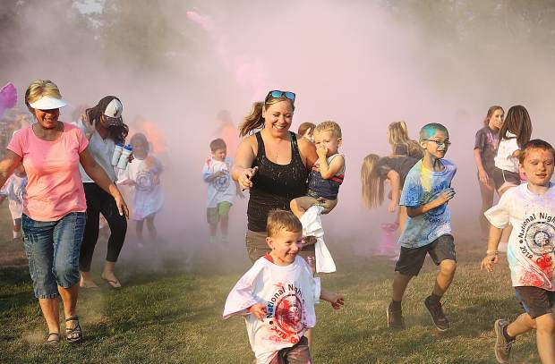 Members of the western Nevada County community enjoy themselves as they take part in Tuesday evening's color run through DeVere Mautino Park in Grass Valley, where National Night Out took place. Held every first Tuesday in August, National Night Out is an opportunity to get out and know your neighbor.