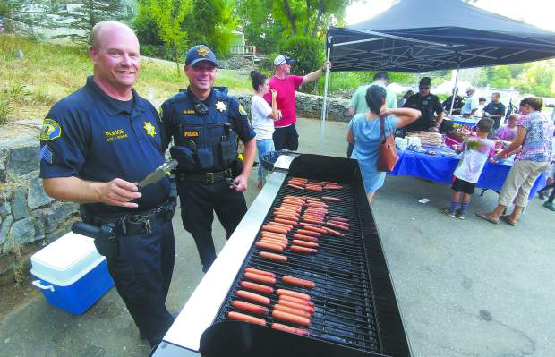 Nevada City Police Sgt. Paul Rhode and Lt. Chad Ellis work the grill at the 2017 National Night Out at Pioneer Park.