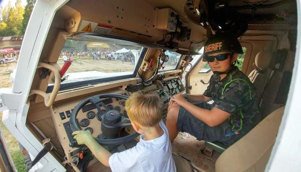 Checking out the inside of the Nevada County Sheriff's Tactical Rescue Vehicle is three-year-old Finn Gammelgard, and 11-year-old Chance Tynan.