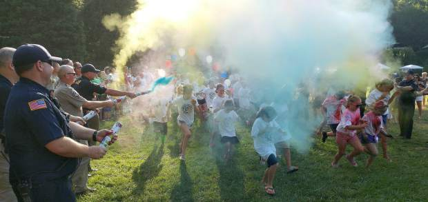 Nevada County Sheriffs, Grass Valley Police, and Nevada City Police initiate the color run Tuesday evening in Pioneer Park.