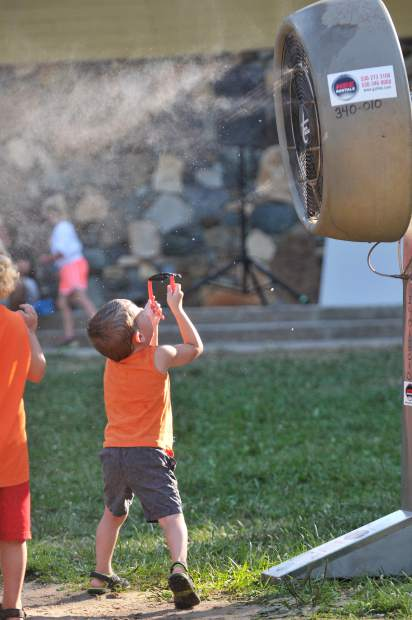 Nevada City four year old Liam Torres dances in the cool air of a fan Tuesday evening in Pioneer Park.