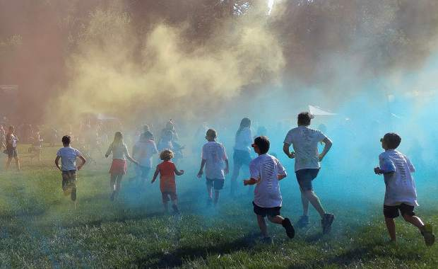 Children participate in last year's National Night Out color run. This year's event is schedued for Tuesday at DeVere Mautino Park in Grass Valley.