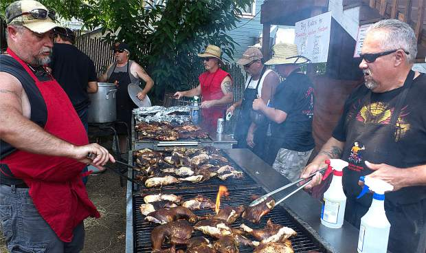 The Washington Fire & Rescue Volunteer Department revived its annual Chicken BBQ fundraiser Saturday afternoon near the firehouse downtown in Washington. The event is supported by the Crockett Fire Department, which helped with the cooking and serving, while the Club TAC and the Washington Hotel helped sponsored the event. About 300 chickens were smoked and barbecued for the fundraiser dinner during the afternoon. Live music was provided by the Ed Early Band and silent auction items were donated by Grass Valley, Nevada City and Washington merchants.