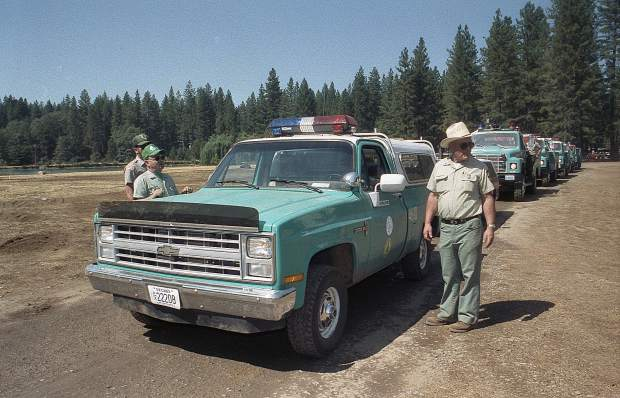 Nevada state fire personnel wait to depart the Nevada Country during the 49er Fire in September 1988.