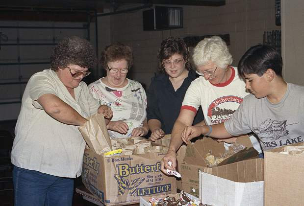 Community members make sack lunches for firefighters.