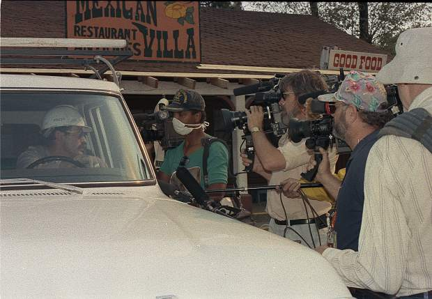 Members of the media get the latest report on the fire's progress in September 1988.