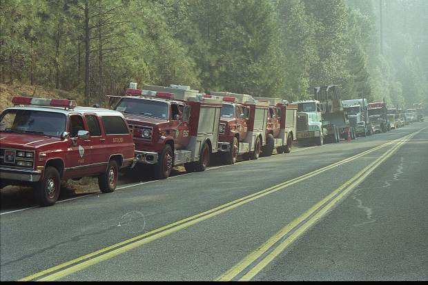 Long line of fire equipment during the 49er Fire.
