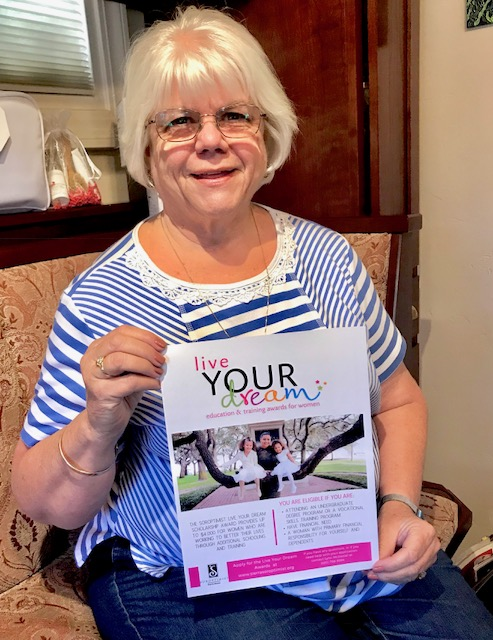 Lynn McDaniel is happy to help you fill out the Live Your Dream application.  Photo by Margie Carr.
