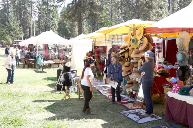 Booths line the walkways of the Draft Horse Classic at the Nevada County Fairgrounds Thursday.