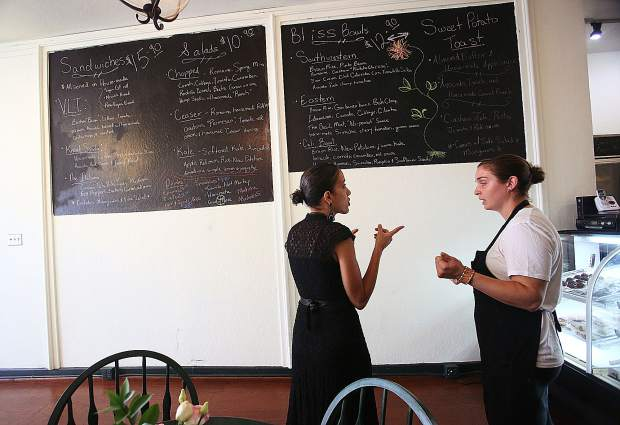 Justina Dunne (right) talks with customer Angelina Habeeb last week in Cafe Tara in downtown Grass Valley.