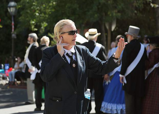 Secret service agents play the part of protecting the president while the Famous Marching Presidents of the Nevada City Constitution Day Parade walk down Broad Street.