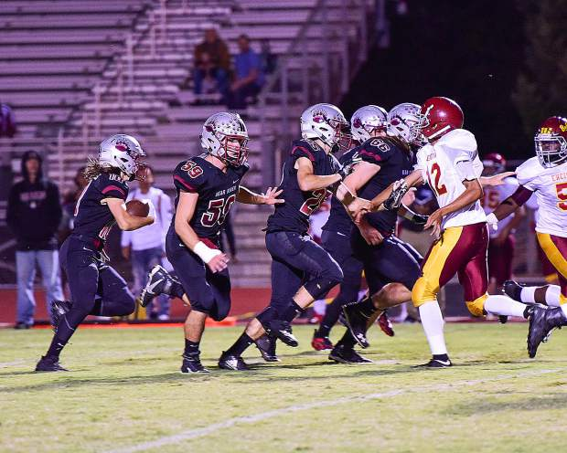 Jeremy Rodrigues returns a free kick for a touchdown during the Bruins' 54-0 victory over Encina Prep Friday night.