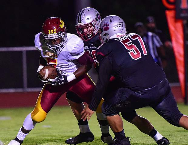 Bear River's Jonny Carillo closes in on a Bulldog ball carrier during the Bruins' 54-0 victory over Encina Prep Friday night.