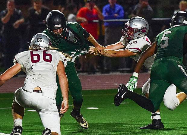 Bear River's Jared Baze (58) pulls down Liberty Ranch's quarterback during the Bruins' win over the Hawks Friday. Baze notched two sacks in the game.
