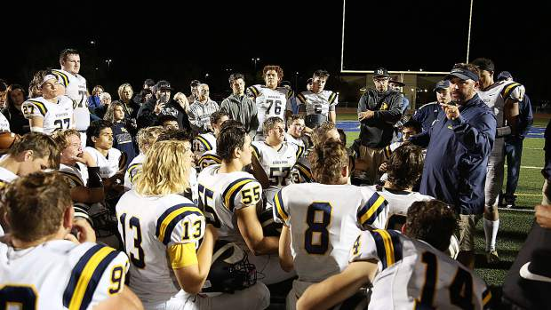 Nevada Union Miners head coach Brad Sparks congratulates his team for showing more talent progression and for winning Friday night's game against the River City Raiders.