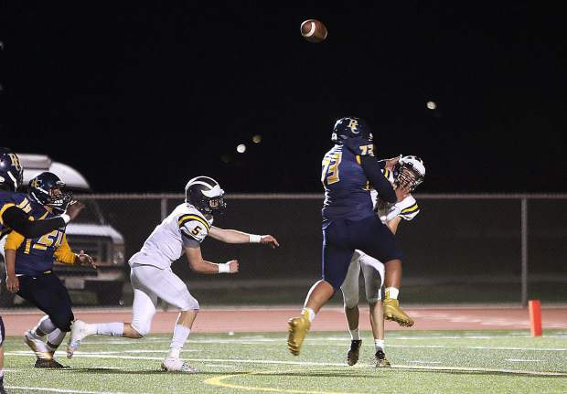 Nevada Union senior Parker Heilaman (6) tosses a pass to Jaxon Horne during Friday's win over the River City Raiders.