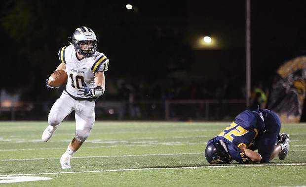 Nevada Union running back Hayden Lee (10) eyes looks for a lane after ditching a River City defender during the Miners' 53-21 win over the Raiders.