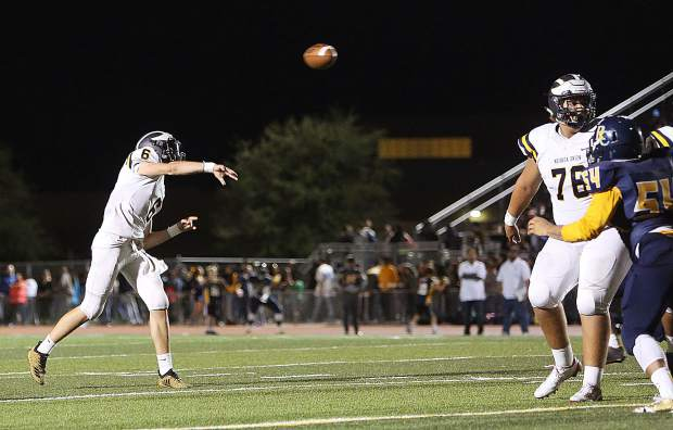 Nevada Union senior Parker Heilaman (6) tosses an end zone pass during Friday';s win over the River City Raiders.