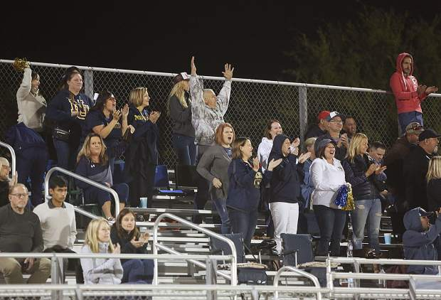 The Nevada Union Miners traveling fans cheer at the sight of another Miner touchdown.